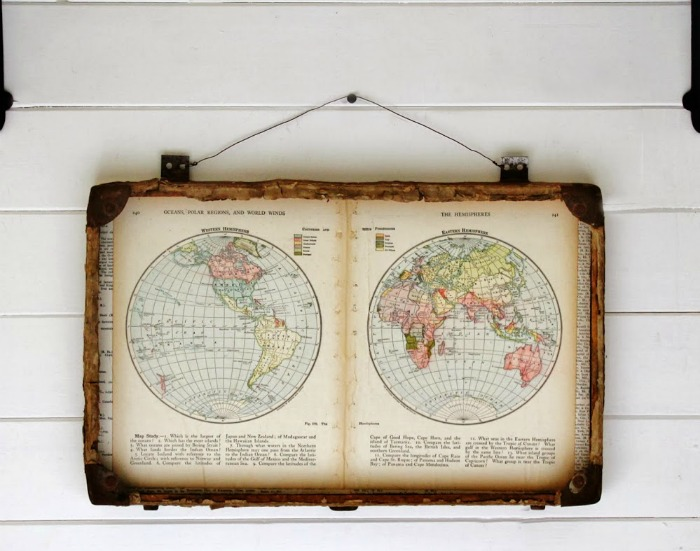 Repurposed antique suitcase with world map pages by Knick of Time