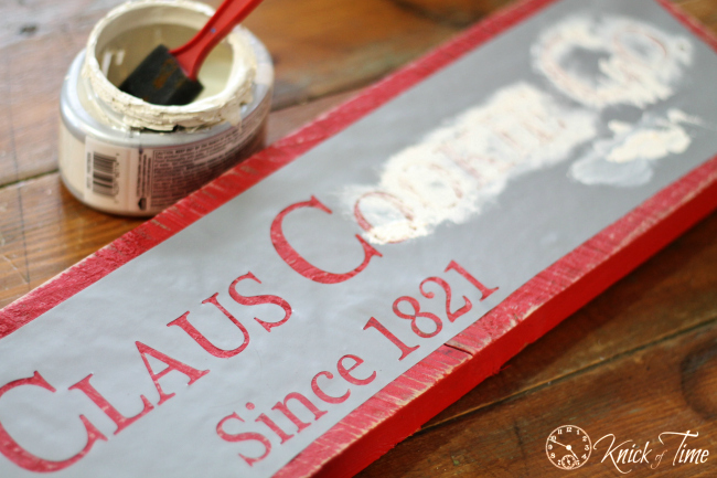 painting a Christmas sign