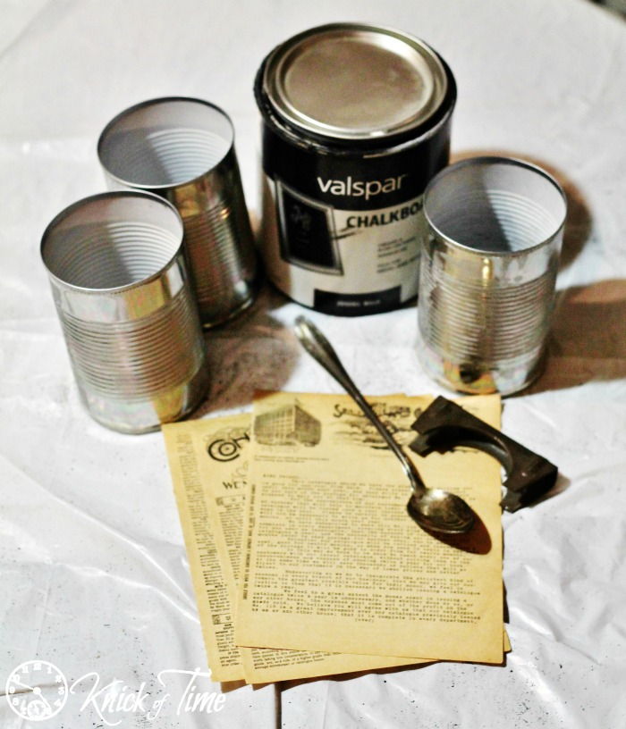 repurposed tin cans and book pages