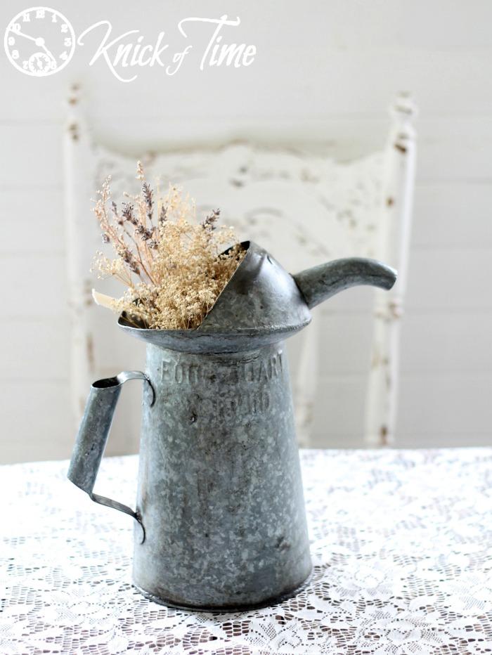 vintage metal pitcher with spout
