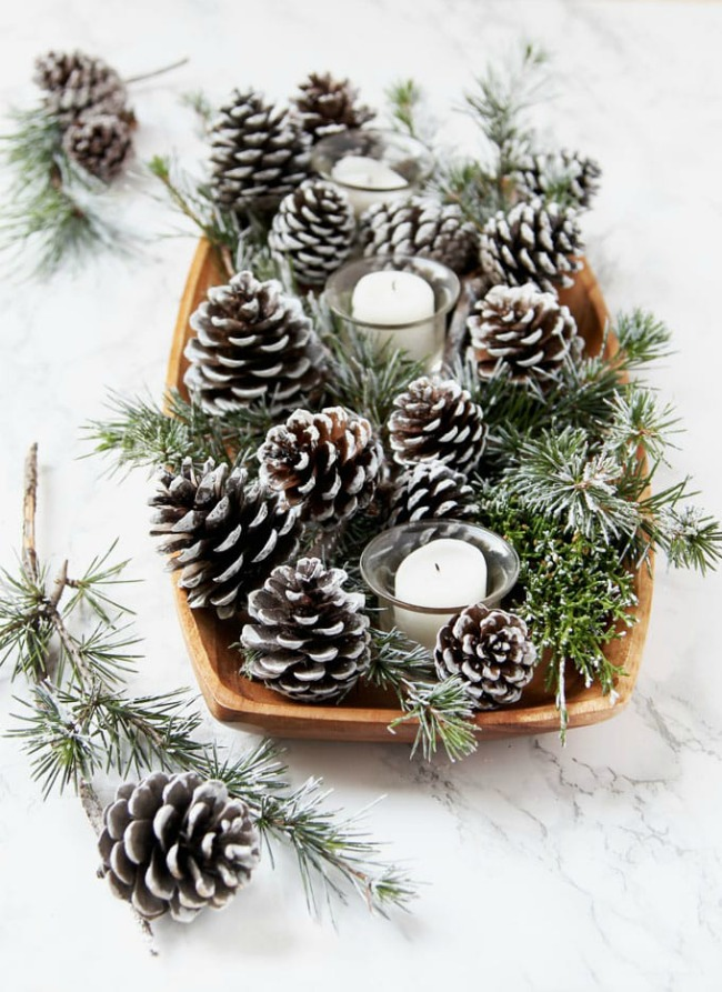 Frosted snowy pinecones and branches in holiday and winter decorations