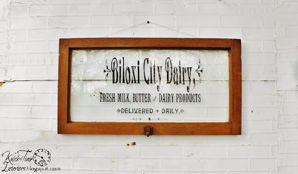 antique window dairy sign