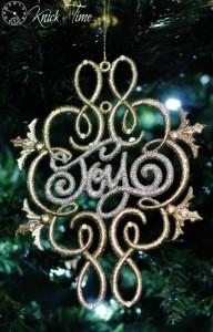 gold and glitter ornament joy