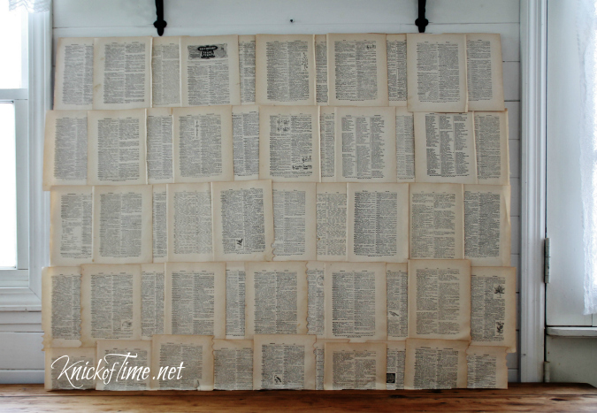 repurposed book pages photo backdrop