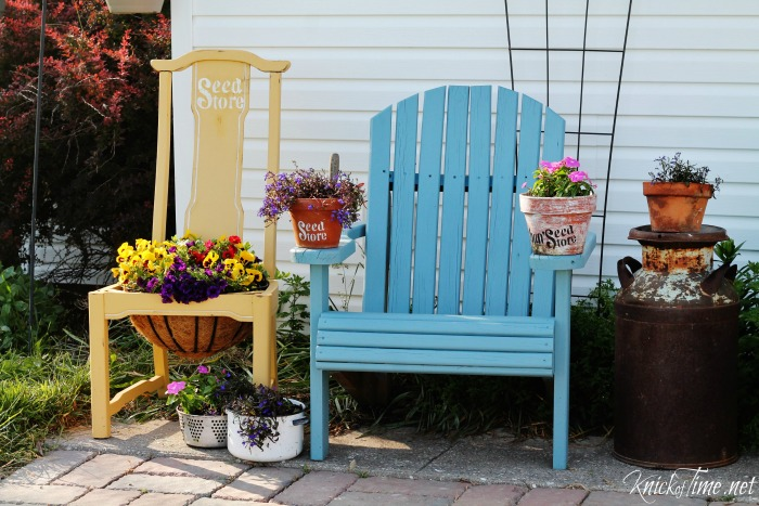 Farmhouse patio with repurposed chair flower planter and painted adirondack chairs | www.knickoftime.net