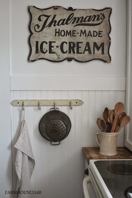 old wooden spoons and antique sign