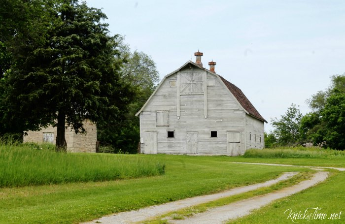 hello world and an old white barn