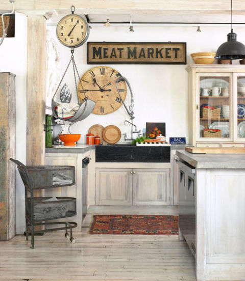 Gorgeous farmhouse kitchen with wooden meat market sign and round wood clock - KnickofTime.net