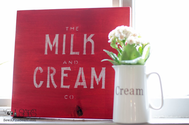 milk and cream company sign