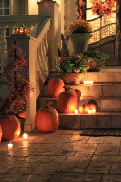 Autumn front porch pumpkins and candlelight - KnickofTime.net