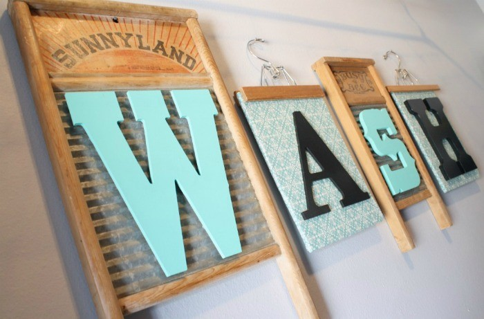 washboard and wooden hangers wall art