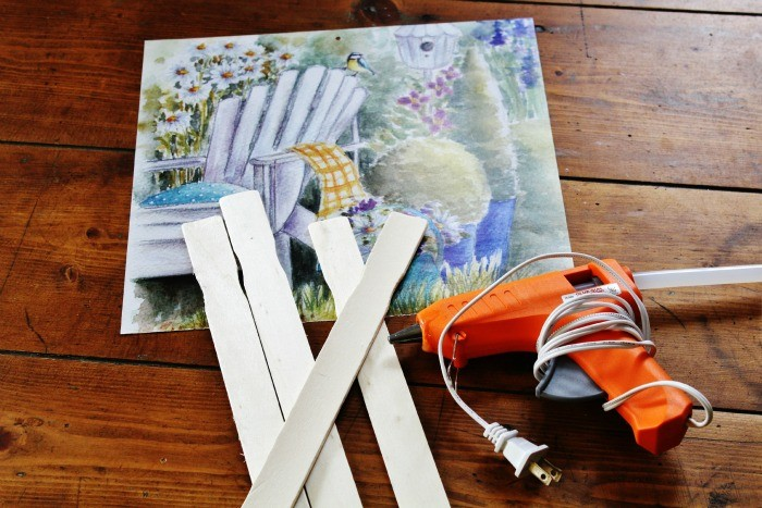 Don't throw out your old calendar this year / Turn it into beautiful wall art in about 5 minutes with some paint sticks, wood stain, and a glue gun / KnickofTime.net