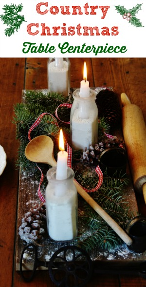 Create an easy Farmhouse Christmas Rustic Centerpiece with a weathered wood board, natural elements and a few vintage kitchen tools - KnickofTime.net