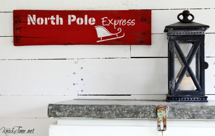North Pole Express, a rustic red wooden Christmas sign made with Knick of Time's Vintage Sign Stencils - KnickofTime.net