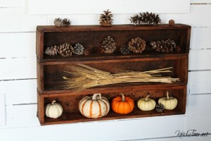 Fall decor with antique crates, pumpkins, pine cones and wheat - KnickofTime.net