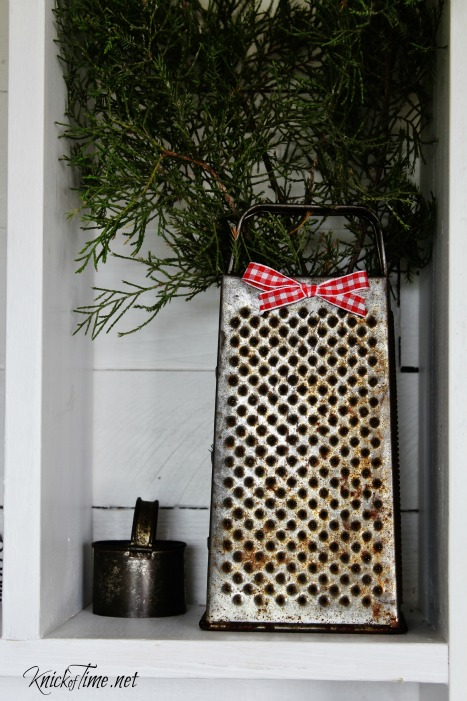 Farmhouse Christmas entryway with natural elements and vintage decor - KnickofTime.net