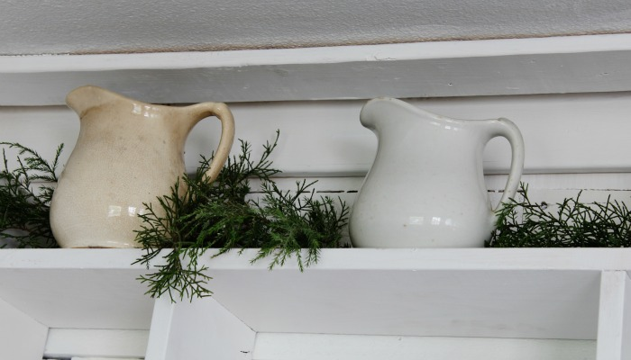 Ironstone pitchers and greenery hutch decor - farmhouse entryway - KnickofTime.net