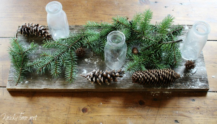 Create a country Christmas centerpiece with weathered wood, old milk bottles and natural elements as the base - tutorial at KnickofTime.net