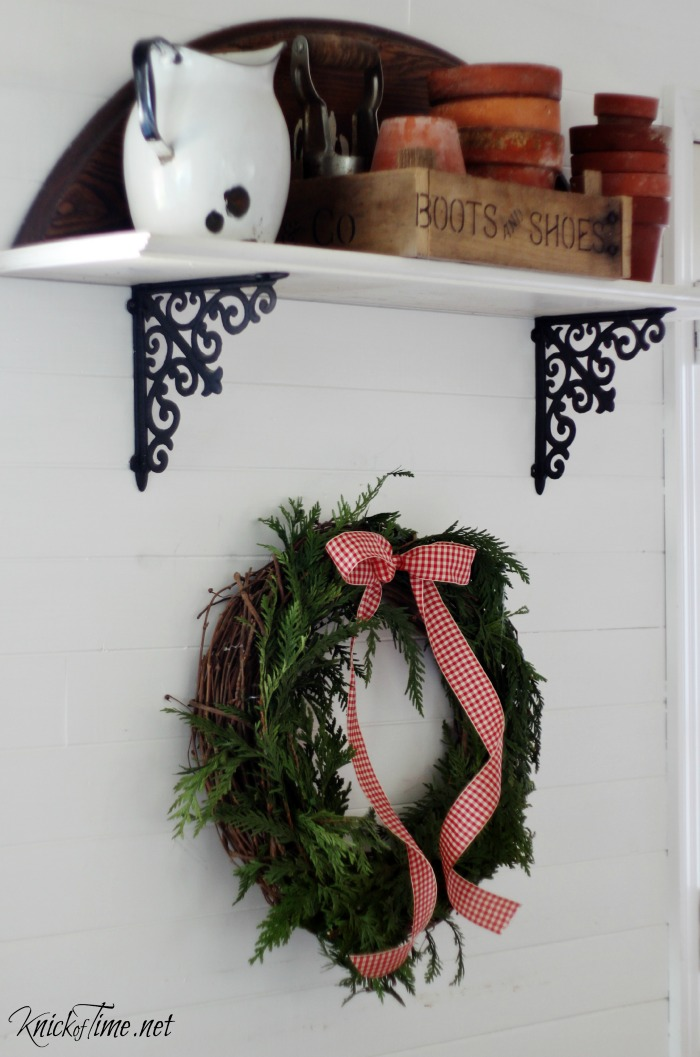 Evergreen Christmas wreath in farmhouse kitchen - KnickofTime.net