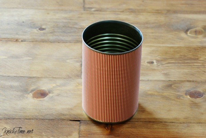 decoupage tin can with red and white strip paper