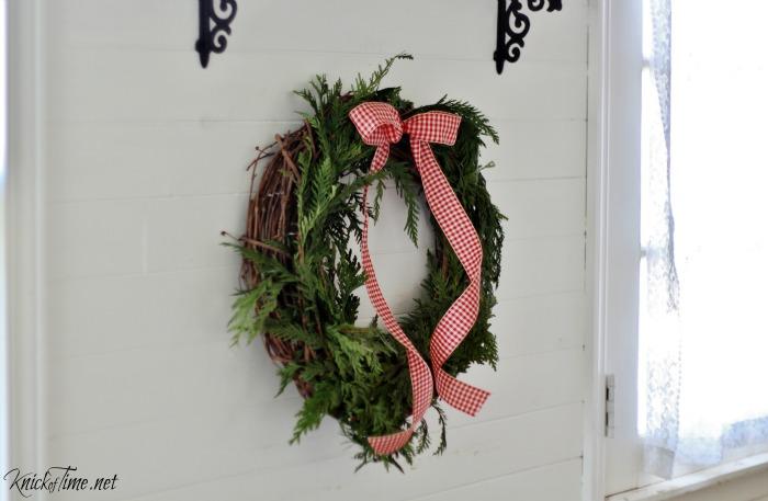farmhouse Christmas wreath with gingham ribbon - KnickofTime.net