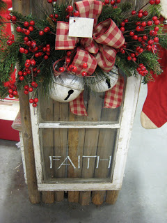 Turn an old window into a Christmas sign with a evergreen swag, Christmas bells and stenciled words
