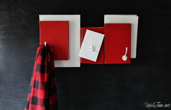 Paint the covers of unwanted books and turn the into a unique coat rack for the holidays! Tutorial at KnickofTime.net