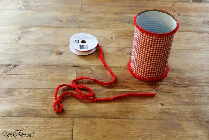 red pom pom trim on Christmas cans