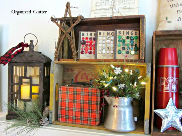 Repurposed Christmas decor with vintage crates, lunch box and Bingo cards