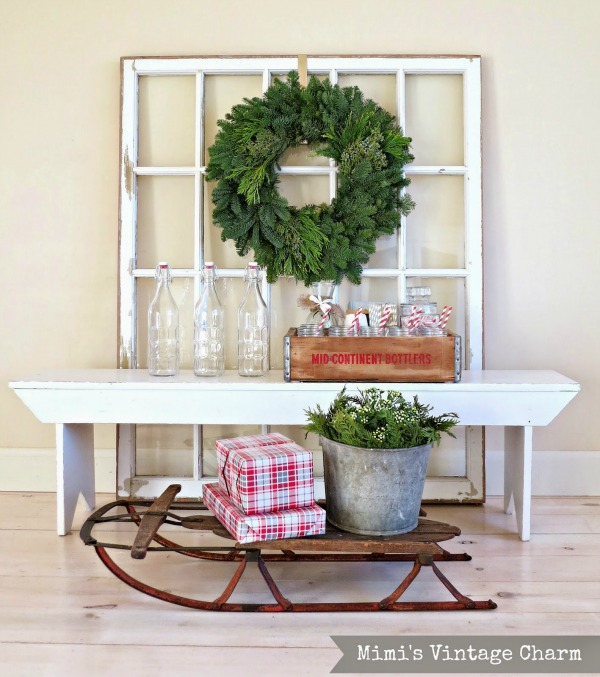 Christmas decor with repurposed window, vintage sled and soda crate