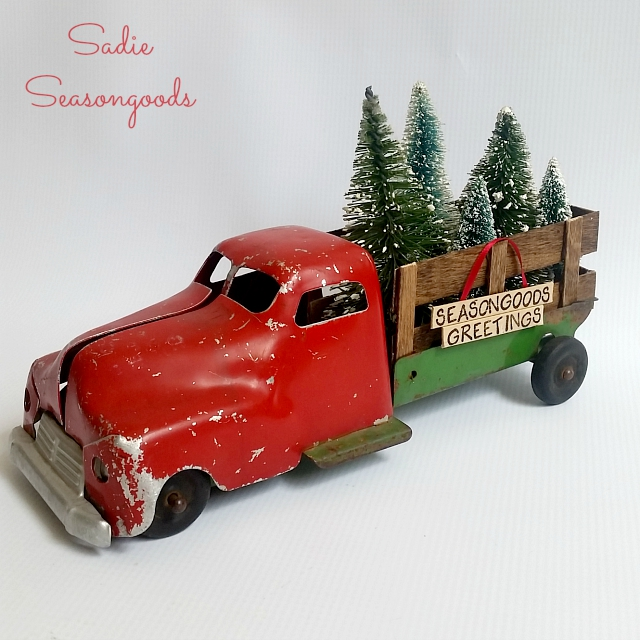repurposed christmas decor with a vintage toy truck and bottle brush trees