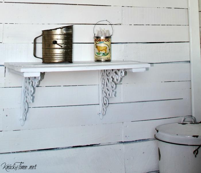 white farmhouse shelf made of pallet wood and shelf brackets - KnickofTime.net
