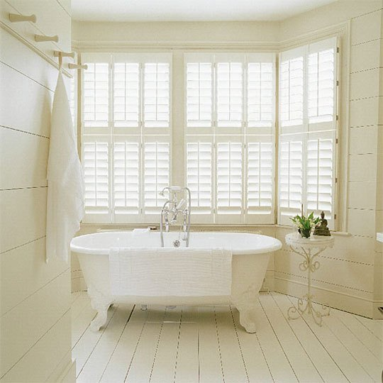 Adding shutters on bathroom windows gives privacy and looks beautiful