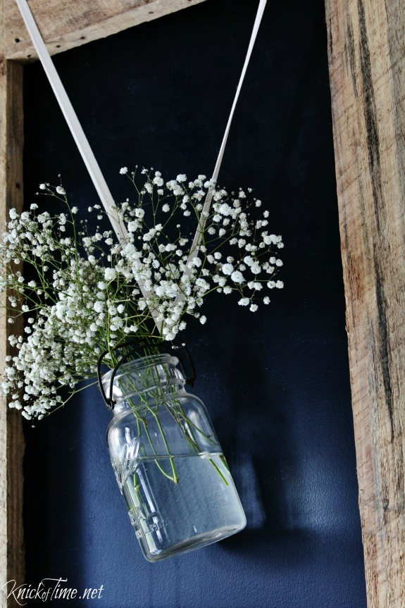 Flowers in hanging mason jar on chalkboard wall - KnickofTime.net