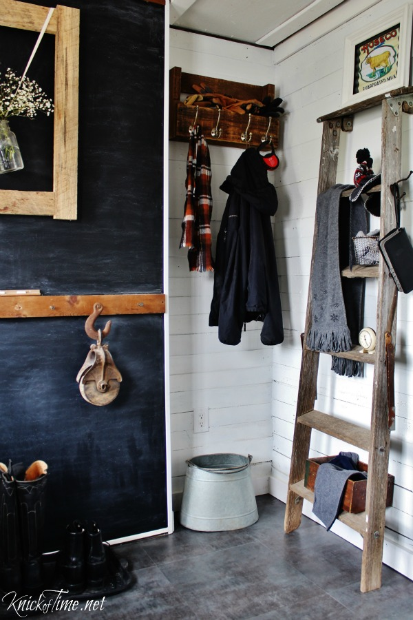 An old ladder makes a great shelf for seasonal gear in a farmhouse entryway - KnickofTime.net