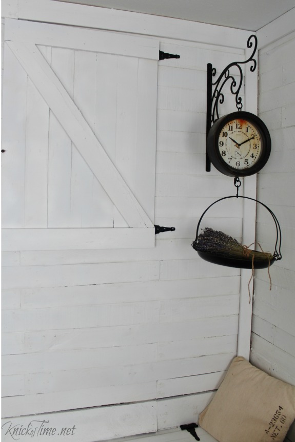 Vintage style hanging scale clock and barn door cabinet in entryway - KnickofTime.net