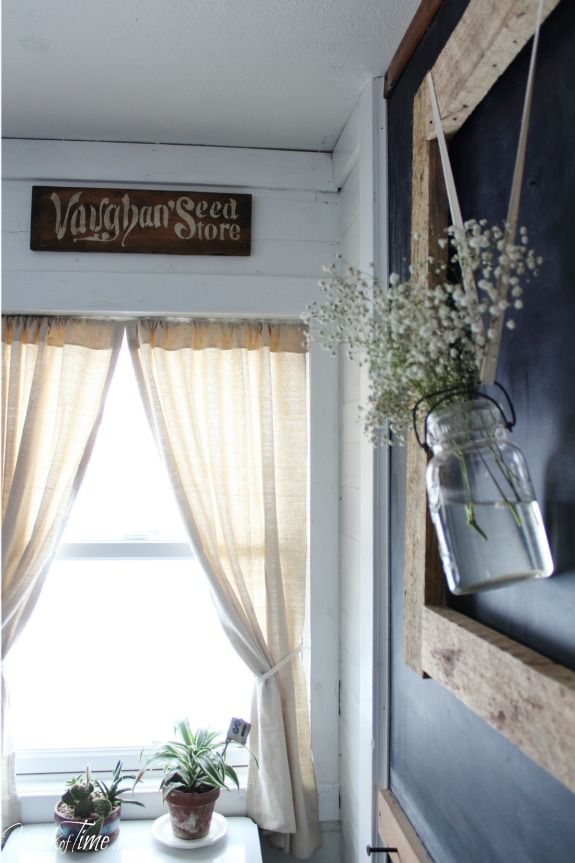 stenciled sign above window in farmhouse entryway remodel - KnickofTime.net