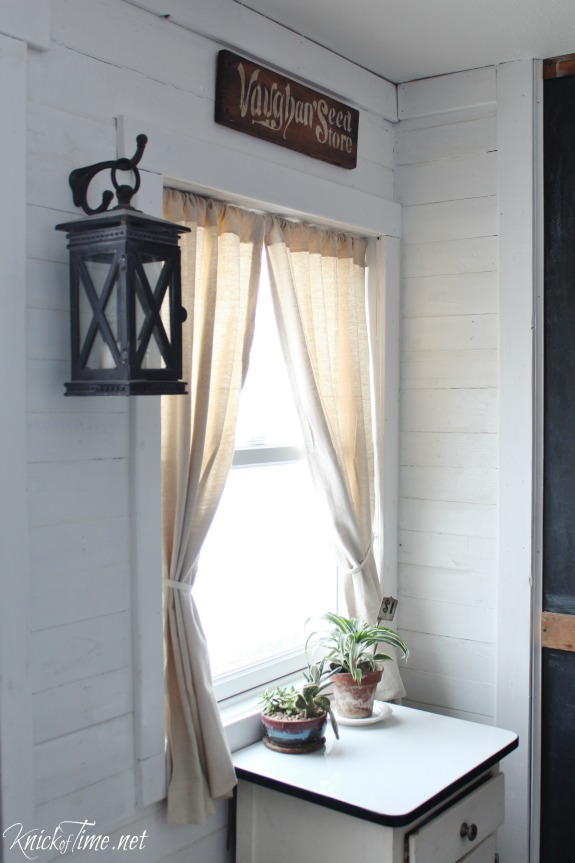 vintage style cast iron lanterns and vintage decor in a farmhouse entryway - KnickofTime.net