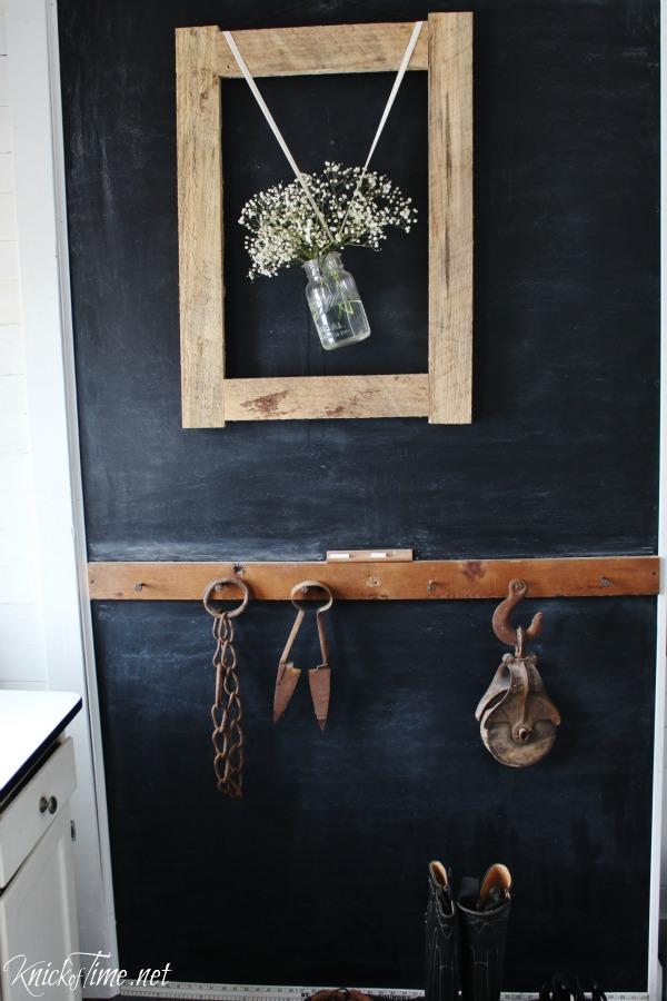 Chalkboard wall in farmhouse entryway - See the full remodel at - KnickofTime.net