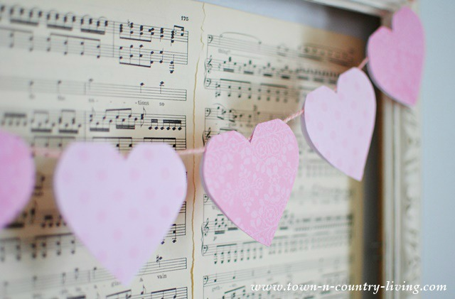 Paper heart Valentine banner in vintage frame with sheet music - featured at KnickofTime.net