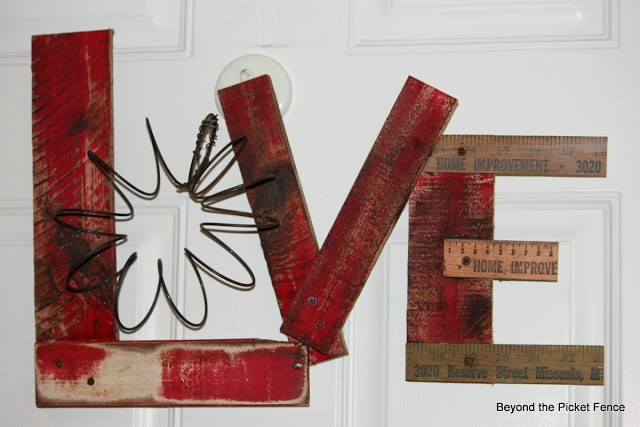 salvaged wood and scraps junky love sign - featured at KnickofTime.net