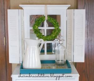 white shutter mirror cabinet