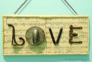 LOVE sign created with salvaged junk and sheet music