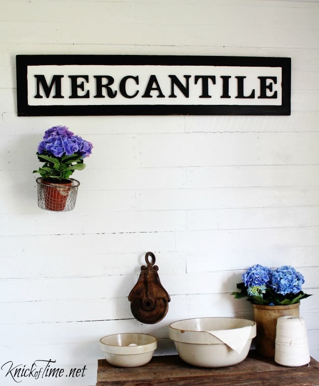 Turn a Salvaged Door Panel into a Vintage Style Mercantile Sign - KnickofTime.net