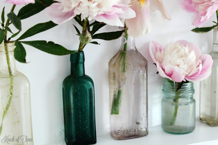 Antique medicine bottles make beautiful vases for single stem flowers - Knick of Time.net