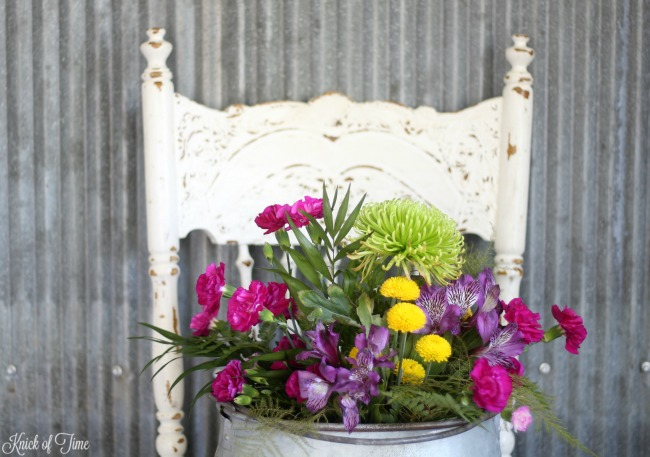 corrugated metal wall flowers old chair 4 - Knick of Time