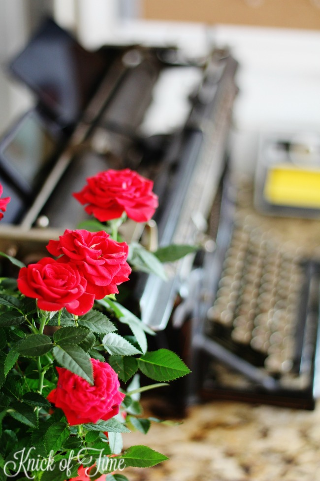miniature red roses in a home office - KnickofTime.net