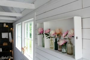 pink peonies in antique apothecary bottles - KnickofTime.net