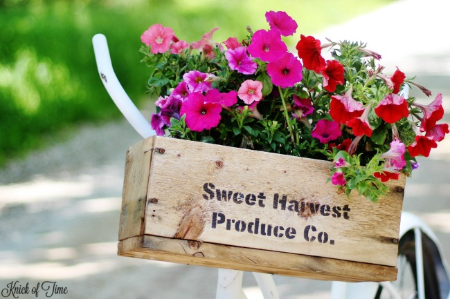 repurposed old wood crate into bicycle flower basket - KnickofTime.net
