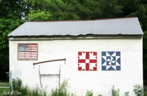 red white and blue patriotic barn quilts on old barn - KnickofTime.net